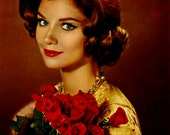Retro 1950's Postcard. Girl with roses
