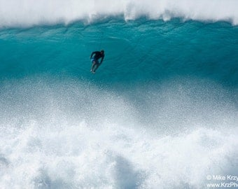 A Surfer Free Falls From the Top of a Big Wave at Pipeline on the North Shore of Oahu in Hawaii