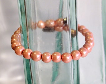 Magnetic hematite bracelet - pearly peach 6mm beads - custom sized