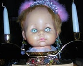 Unusual Candle Holders ...........Disturbing Candleholders / Centerpiece ..... Doll Head Art Assemblage