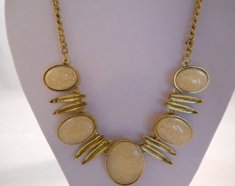 Beige and Gold Tone Pendant Bib Necklace with Gold Dangles on a Gold Tone Chain