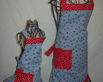 Reversible Mommy and Me aprons adorable Lady Bug design perfect for those cupcake parties...