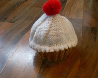cute little hand knitted baby cupcake hat with red cherry pompom newborn
