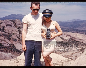 THE GRAY LINE  - Girl in Bullet Bra with Rolleiflex Camera poses with the bus driver - Amazing 1950's Photograph