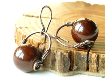 Dark chestnut earrings - copper wire wrapped brown ceramic bead