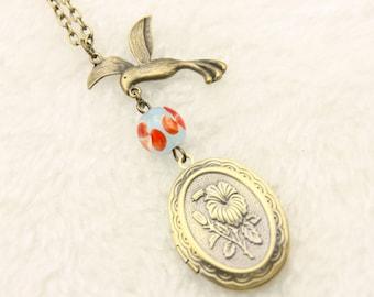 Necklace locket bird