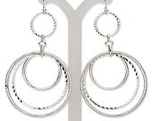 Silver graduated circle dangle earrings with diamond cut finishes