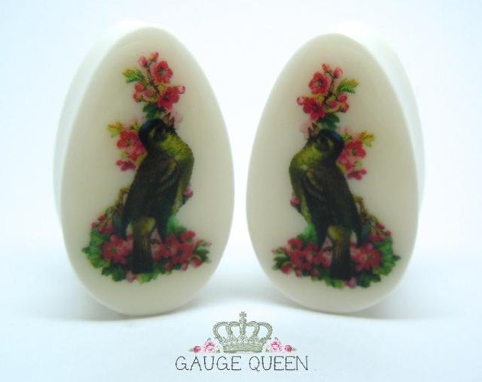 "Teardrop / Oval Bird Plugs / Gauges. 2g /6mm, 0g /8mm, 00g /10mm, 1/2"" /12.5mm, 9/16"" /14mm, 5/8"" /16mm, 3/4"" /19mm, 7/8"" /22mm, 1"" / 25mm"