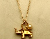 Small Gold Elephant Charm Necklace with a Freshwater Pearl on a 14 K Gold Filled Chain