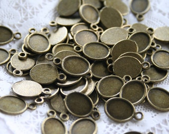 20 Tiny Oval Charms, Cabachon Settings