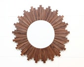 "Sunburst mirror 27"" x 1-1/4"" made of Black Walnut."