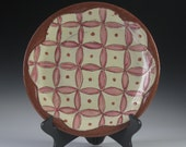 Handmade large terra cotta plate with pink pattern