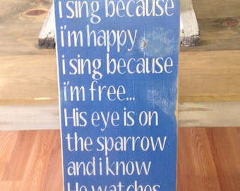 I Sing Because I'm Happy I Sing Because I'm Free - Blue Heavily Distressed Topography Wood Sign
