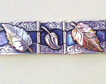 Gold and silver bracelet with leaves in silver and rose gold, the Third Day of the Creation. Biblical jewelry