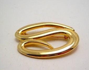 gold tone vintage swirly brooch