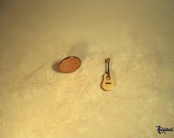Miniature guitar made of basswood. (No. MG26)