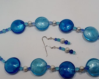 Pale blue, light blue and silver beaded necklace & earring set.