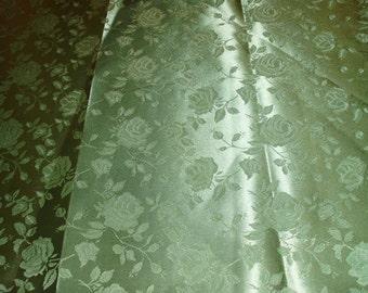 Satin blend jacquard rose print in a Sage  green color. 58 wide