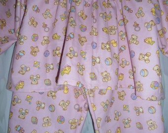 Size 2 Girls Pajamas  with teddy bears and toys on pink background