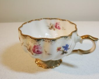 Vintage gilded teacup-footed-pink and blue flowers