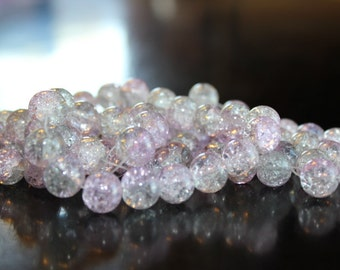 80 approx. clear and light lavendar, 10 mm crackle glass beads, 1.5 mm hole, one strand of beads for making jewelry