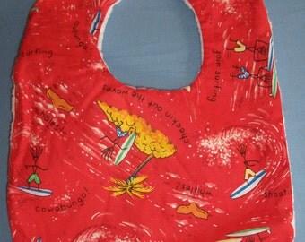 Baby bib in red surfing fabric