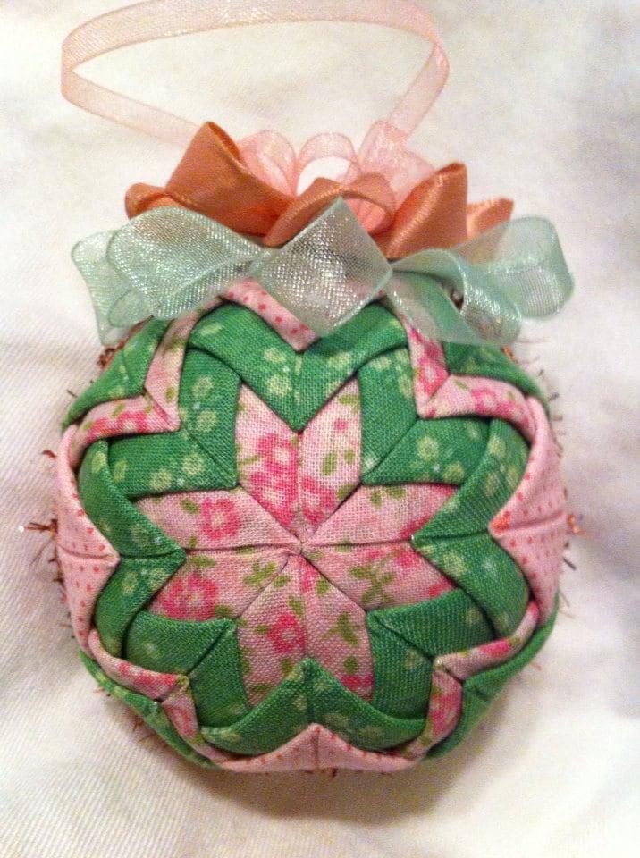 Pink and green fabrics folded star ball decoration.
