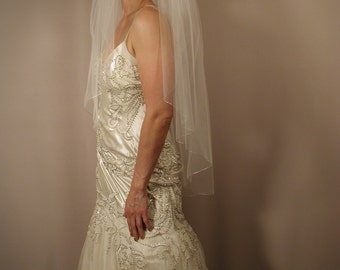 "Wedding veil with silver pencil edging. 42"" fingertip with silver pencil edging."