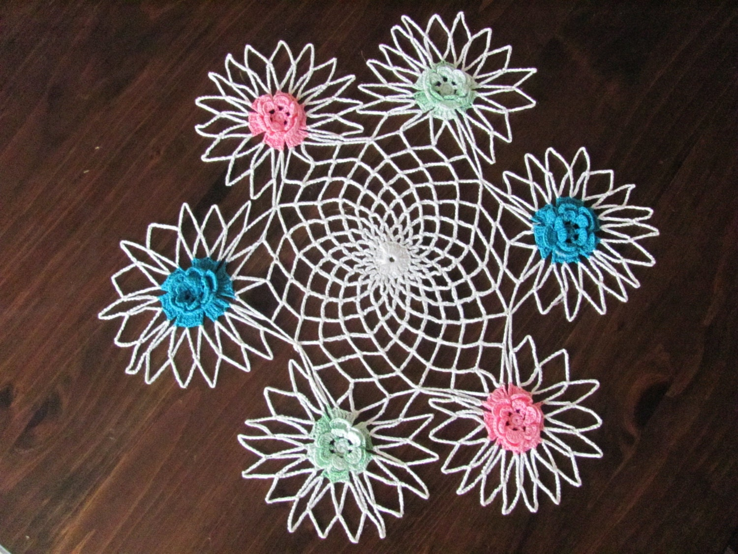 Crocheted floral lace doily centerpiece