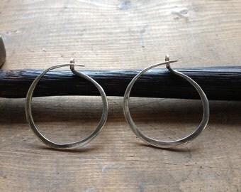 Hand forged sterling silver hoop earrings