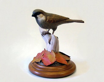 "Wood sculpture of English House Sparrow entitled, ""Alien."""