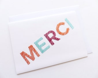 Hand embroidered card Merci tawny turquoise bordeaux-craft card-writing-textile graphic design-contemporary embroidery-typography