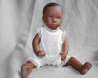 1980s Gotz black vinyl baby doll