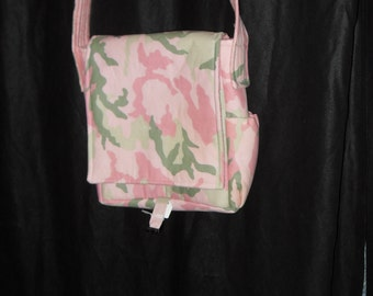 Pink camo mini messenger bag.