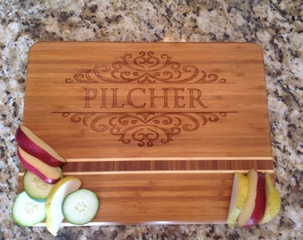 Bamboo personalized engraved cutting boards with Family name Engraved. Please visit our shop to see many more!