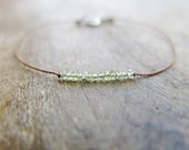Minimalist bracelet with  faceted peridot micro rondelles on brown silk thread