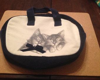 Aww  It's kitten's on a bag.