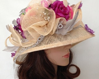 A Beige Sinamay Church Hat With Lace ,Flowers And Feather.