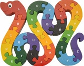 Eco-friendly Snake Alphabet Puzzle, hand-crafted of wood and non-toxic paints... Encourages fine motor and letter recognition skills...