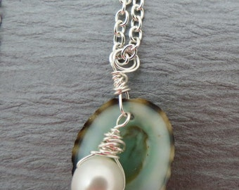 Freshwater pearl and limpet shell necklace