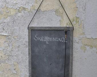 Slate chaulkboard from old metal windowframe.