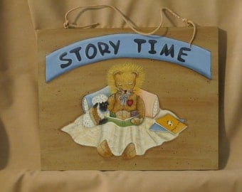 Story Time plaque with lion and lamb reading a book