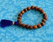 Wood bead bracelet with royal blue tassel