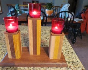 Beautiful multiple hard wood Votive candle holder.