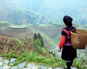 Yao tribe woman standing next to her Rice terraces