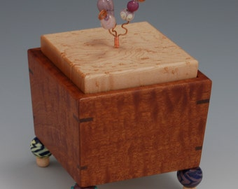 Art Box with curly sapele and birdseye maple, hand made beads and wire work.