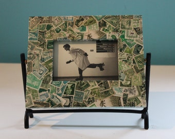 Unique movable green photoframe with post stamps