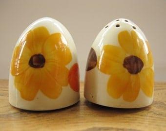 Handpainted 1930s cruet set. Yellow flower on a honey glazed base.