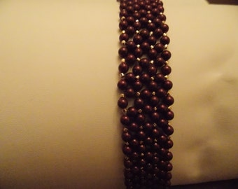 "7"" Maroon and gold beaded bracelet"