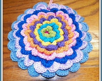 Beautiful crocheted flower pot holder made with many colors of cotton yarn.